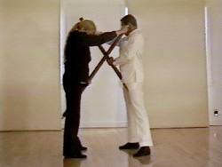 Still from Pole Dance by Mike Kelley, Tony Oursler and Anita Pace, 1997