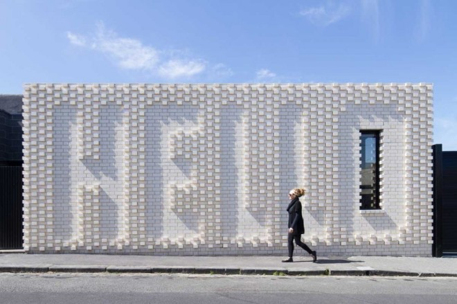 Rose Nolan walks past her architectural intervention in